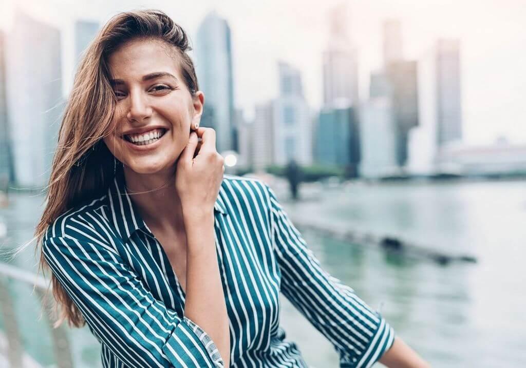 Smiling female traveler Singapore city RF
