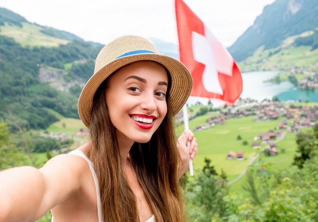 Switzerland flag female traveler RF