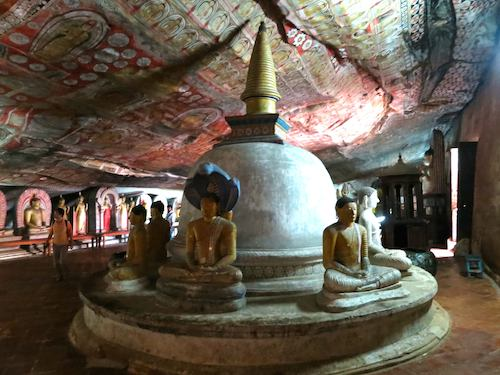 Stone buddhas inside one of the caves of the Dambulla temple complex