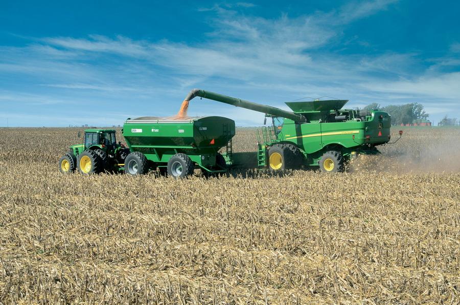 Resultado de imagen para cosechadora descargando cereales