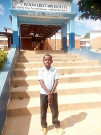 Gift standing at the entrance of the Wukani Education Facility