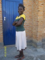 Joyce standing in front of her classroom at wukani education facility