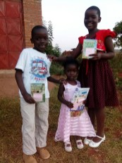 Stella, Wonderful and Favour have just received a book from Marajowi