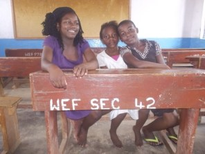 Joyce and two friends at Wukani education facility
