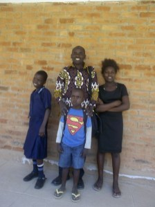 Clement with the kids at school