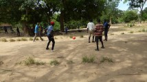 Wit playing football with the learners at Bandawe