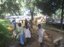 Children around the shelter