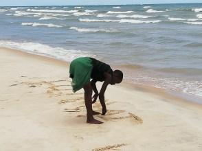Kattie writing on the beach