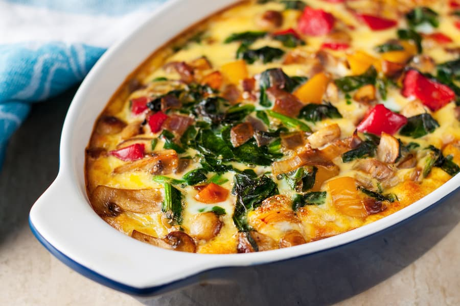 Easy breakfast or dinner casserole with tomatoes, mushrooms and spinach.