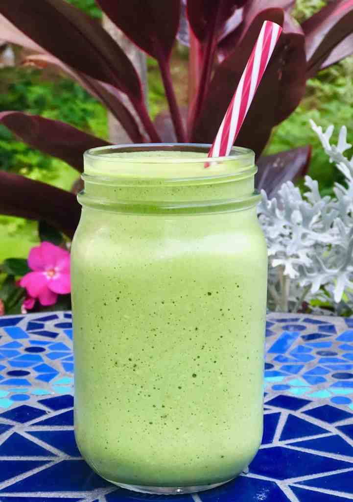 Tropical Green Smoothie with a blue tilebacground