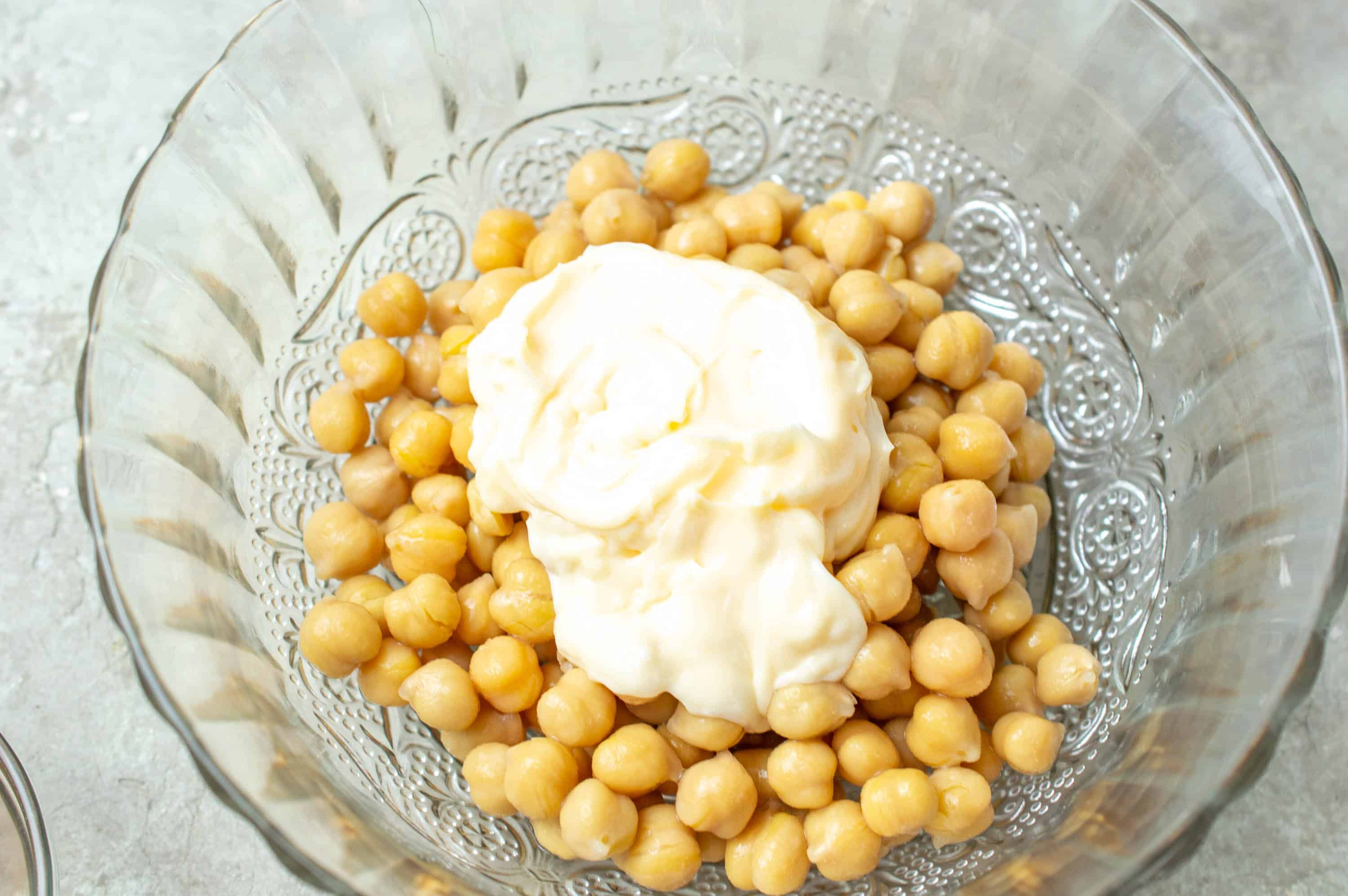 chickpeas in bowl with mayonnaise