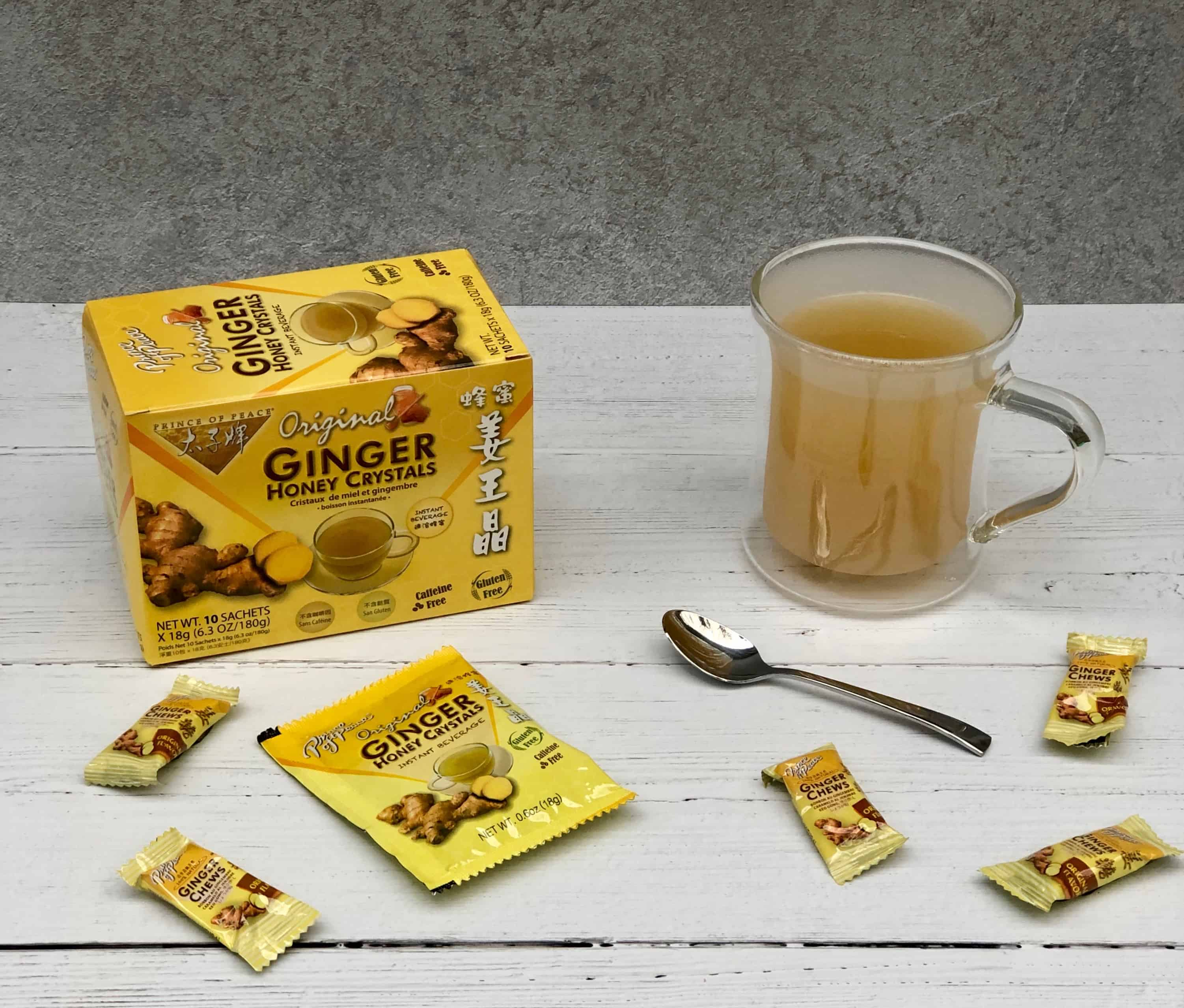 Ginger Chews and Ginger Honey Crystals and hot ginger tea on white background