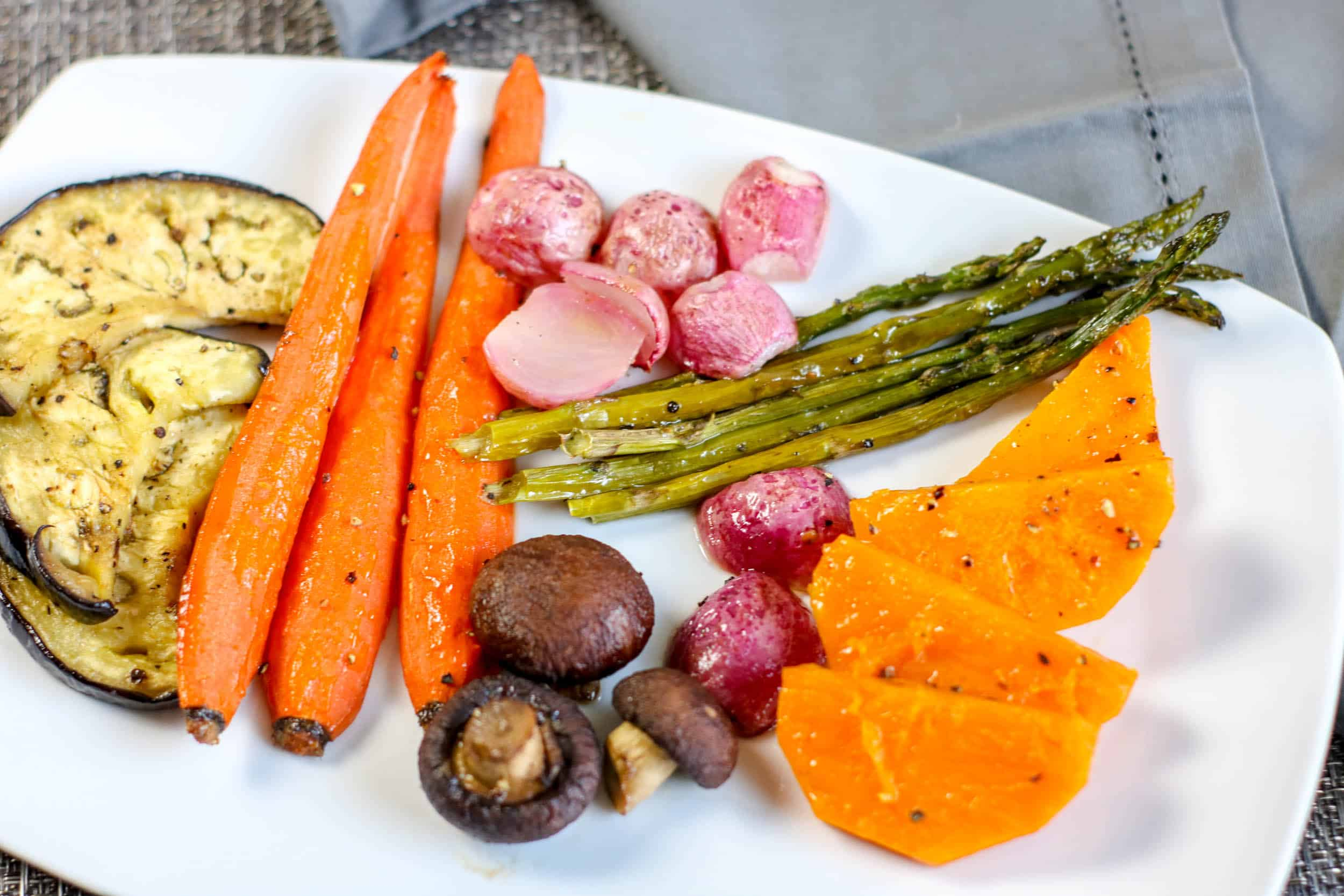 10 Great Ways to Eat Healthy on Thanksgiving with these roasted vegetables on a white platter.