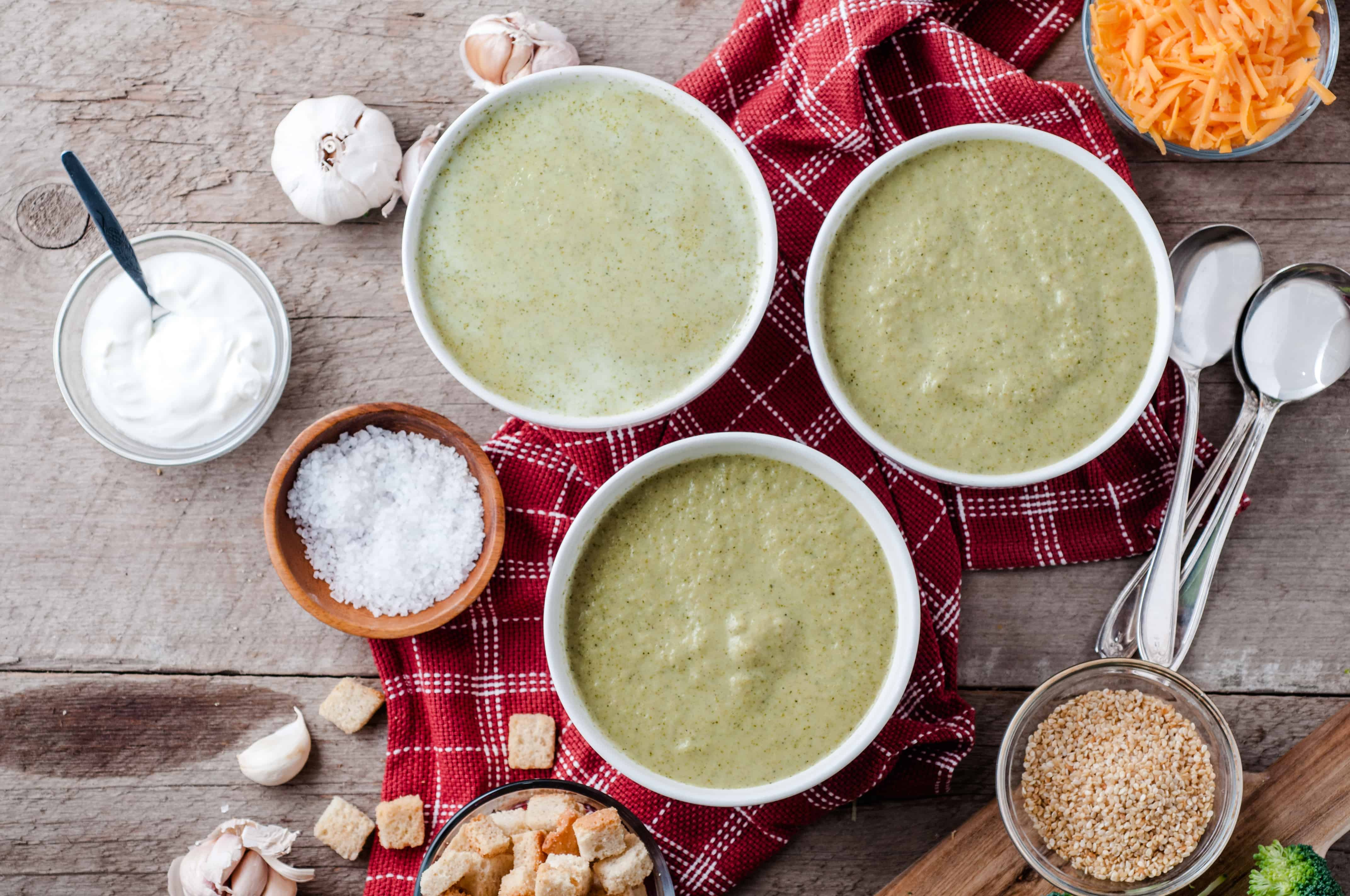 three bowls of Vegetarian Cream of Broccoli Soup