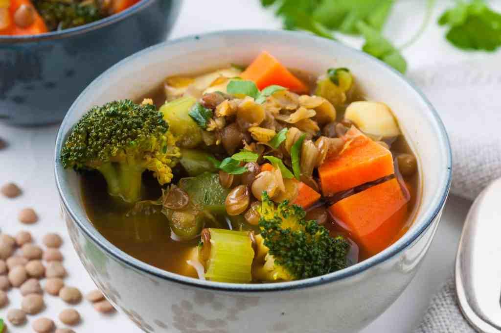 Vegan lentil soup in a white bowl.