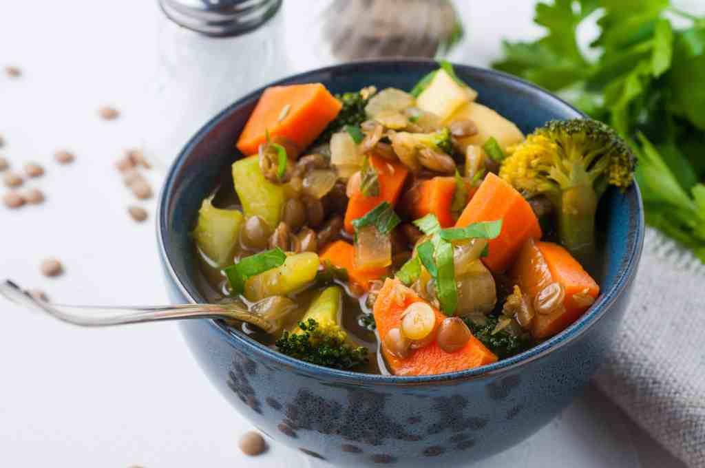 vegan lentil soup in a blue serving bowl.