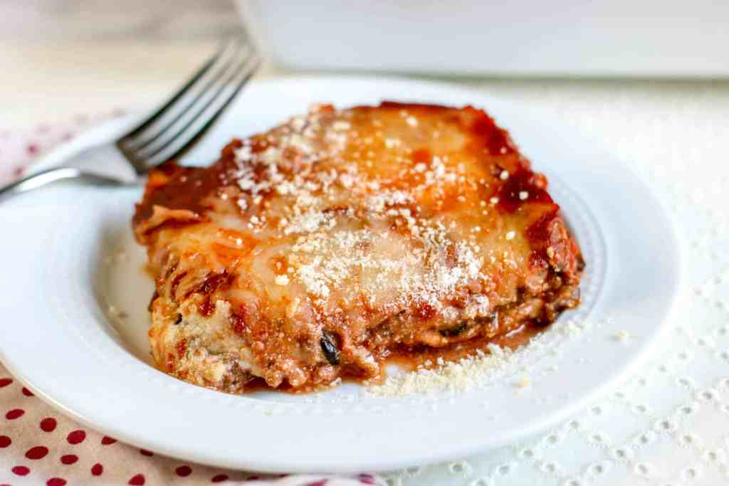 Keto Eggplant Lasagna on a white plate with a fork on the side.