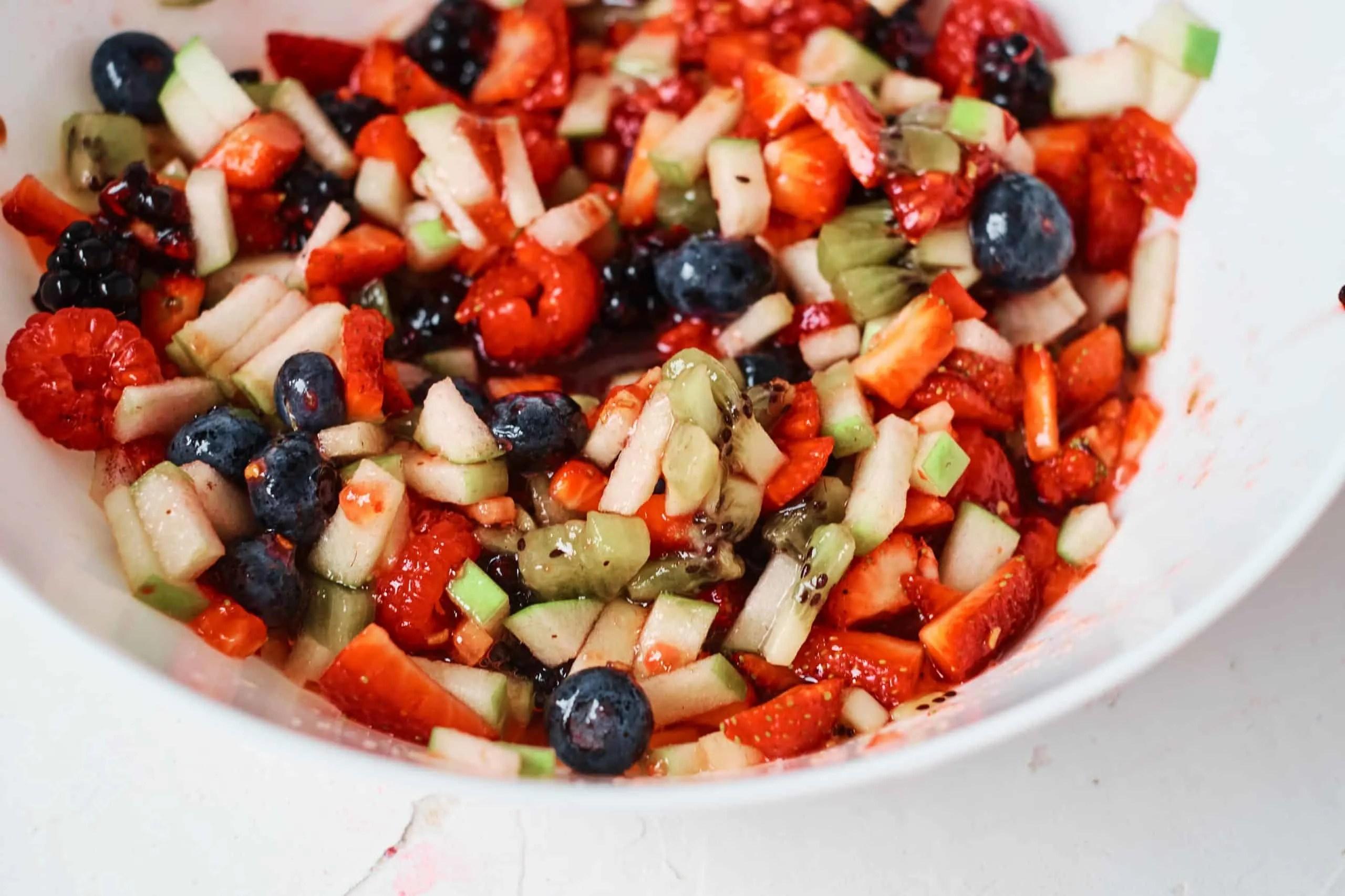 Fruit Salsa closeup in a white bowl.