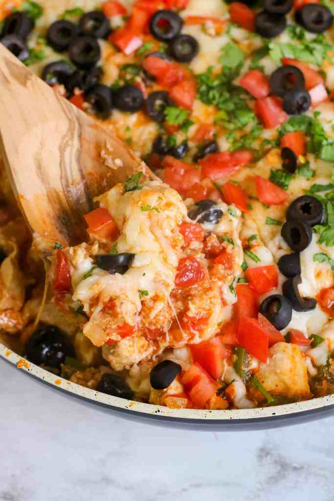 Closeup of Tex Mex Chicken on a wooden spoon.