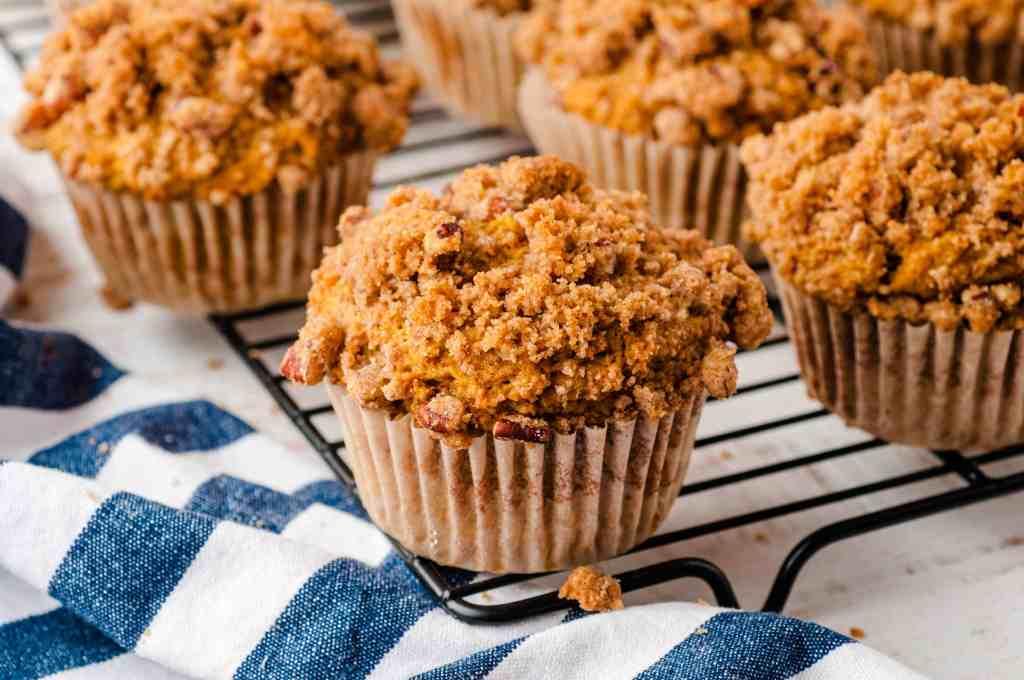 Closeup of pumpkin muffins on a cooling rack.