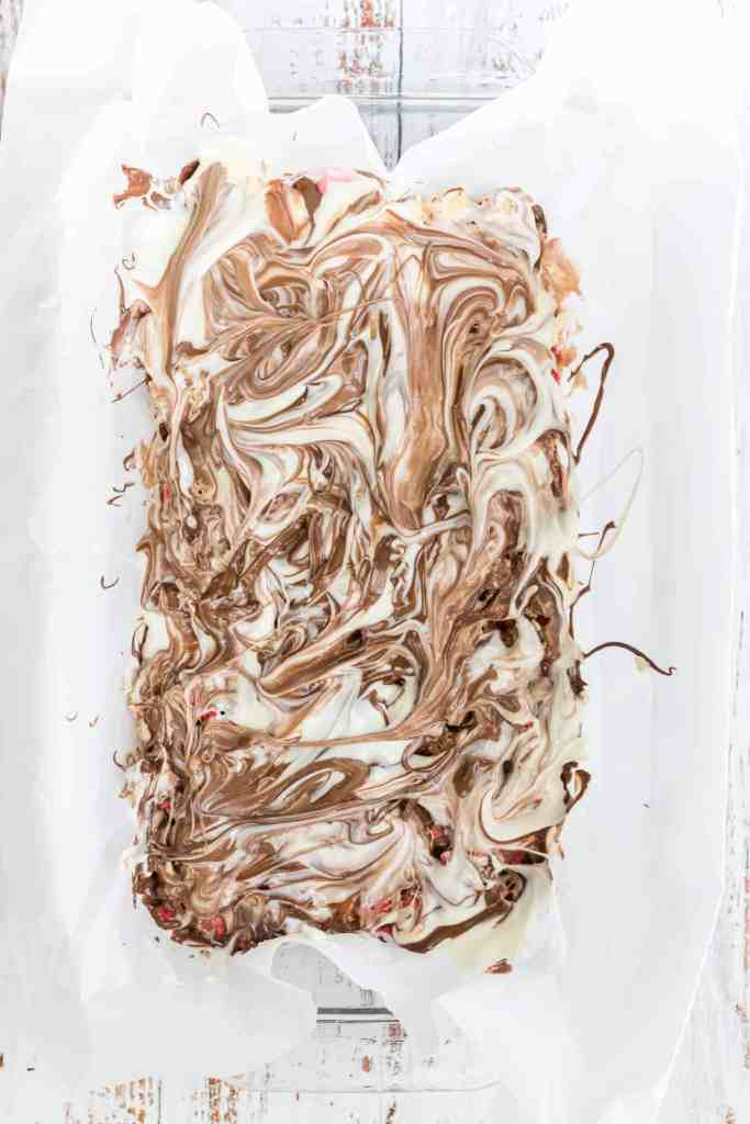 Swirled milk and white chocolate on parchment paper.