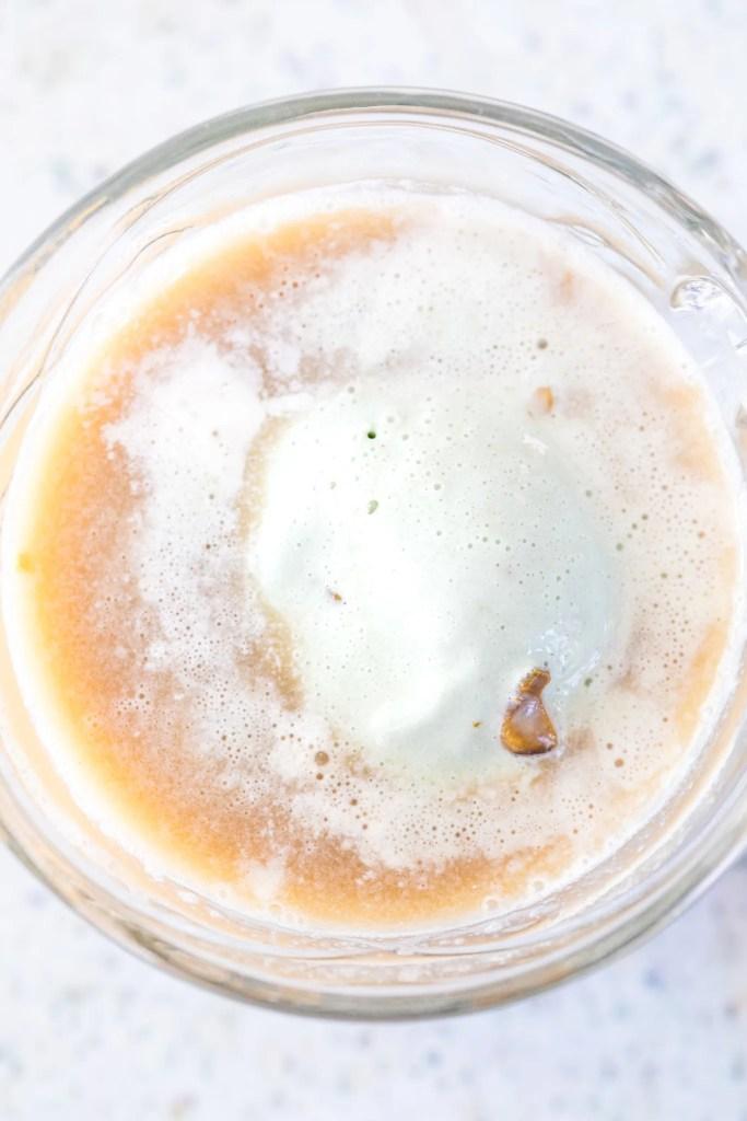 Overhead view of Irish coffee with ice cream.