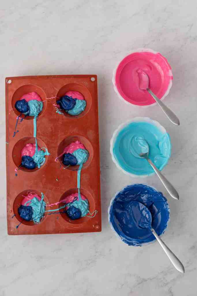 Multi colored candy melts in silicone mold.