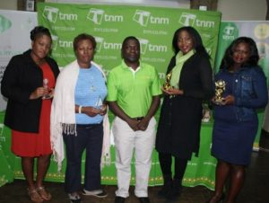 The winners of second tournament posing withTNM's Head of Blantyre region David Nyirenda.