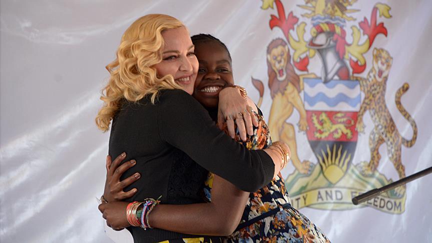 Madonna Hugging Mercy