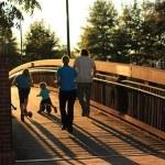 Family running on bridge