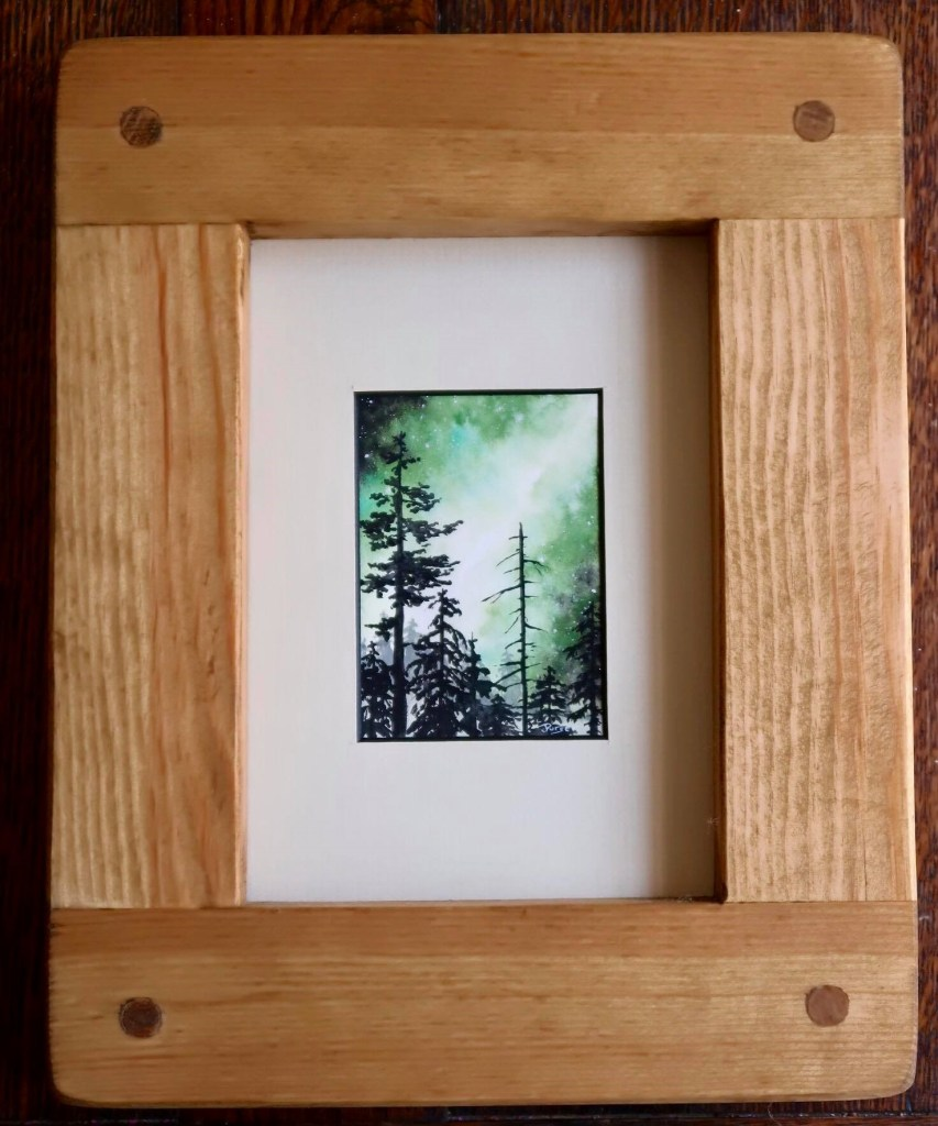 An original artwork, featuring gree and black trees, this line drawring by Jess Purser has been framed by Marc Wood Joinery using eco reclaimed wood.