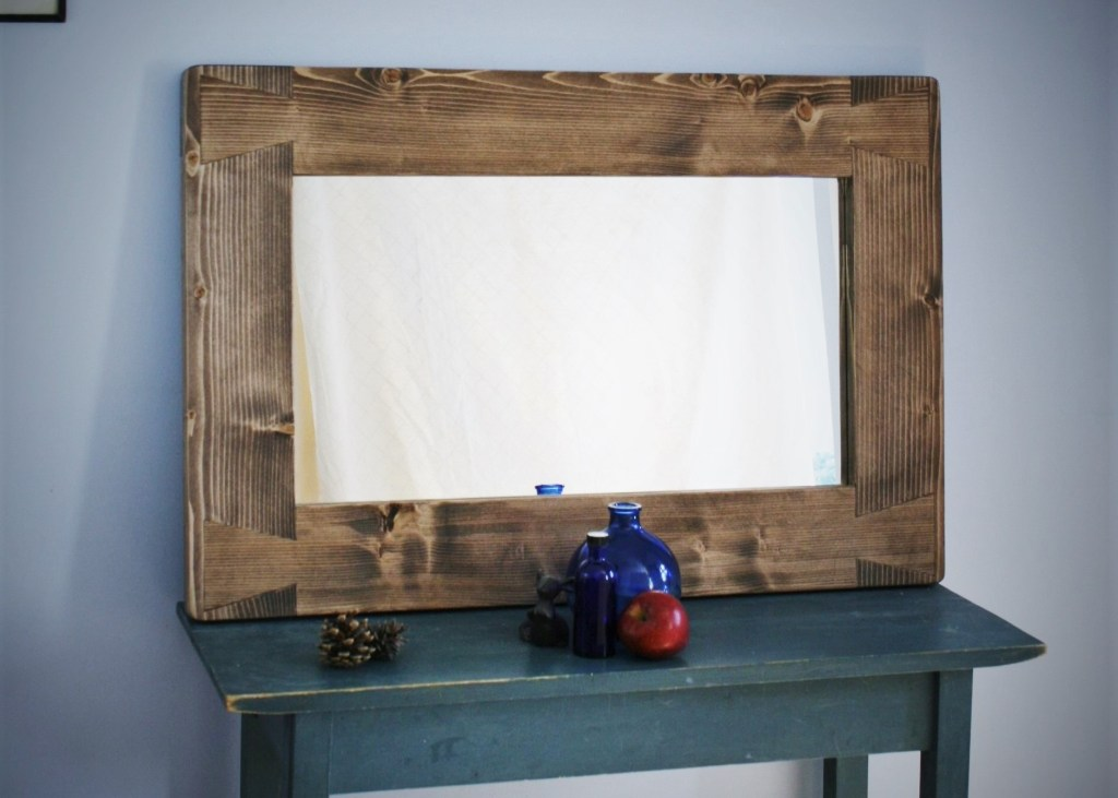 Our 90 x 60 cm dovetail style handmade large wooden frame wall mirror has been a classic bestseller of ours at Marc Wood Joinery since we started just over 5 years ago. Inspired by the chunky beams of our local Somerset UK rustic country farmhouses, this large wall mirror looks great above your fireplace in yourr living room, or as a hallway mirror.
