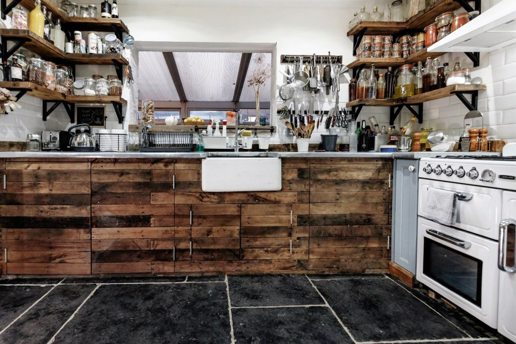Our modern rustic custom handmade kitchen floor cabinets were commissioned by a local Somerset chef for his home; we worked with reclaimed natural oak to create the rustic door panels to our customers design specifications. Our handmade farmhouse country kitchen storage, cabinets and cupboards are each handmade by Marc Wood Joinery in Somerset UK from natural eco sustainable and reclaimed wood. Our modern rustic kitchen pieces can be custom made to any size and we can arrange delivery or installation near Somerset, Dorset, Devon, Bristol or Exeter.