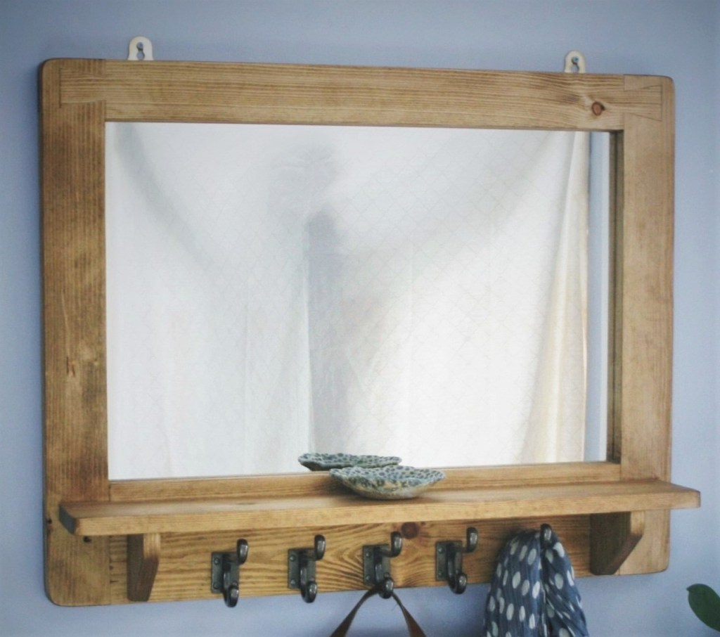 We use metal hanging plates to hang our handmade wooden frame mirrors; for advice on how to best hang your large modern rustic mirror on your wall space see our wooden furniture after care and installation page on our website. Marc wood bespoke joinery in Somerset UK, custom handmade modern rustic mirrors, frames and furniture.