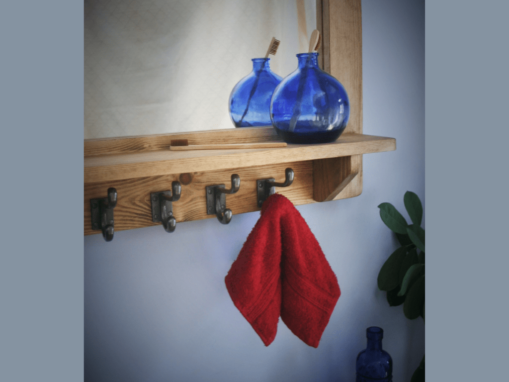 Large wooden mirror with shelf and chunky iron hooks for bathroom and wall mounted dressing table, handmade from rustic natural wood