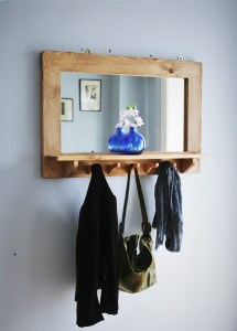 Our handmade wooden mirror with shelf and recycled coat hanger hooks has been a very popular addition to our modern rustic furniture collection. Available in portrait or landscape, handmade to order from Marc Wood Joinery in Somerset UK.