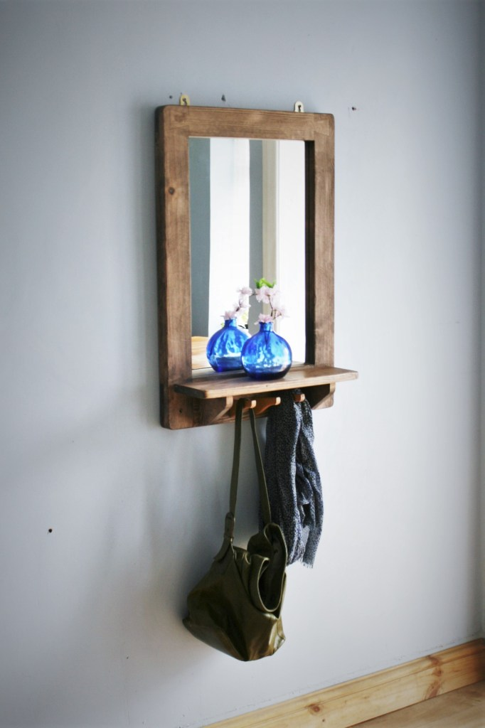Our handmade dark stained wooden mirror with shelf and recycled coat hanger hooks has been a very popular addition to our modern rustic furniture collection. Available in portrait or landscape, handmade to order from Marc Wood Joinery in Somerset UK.