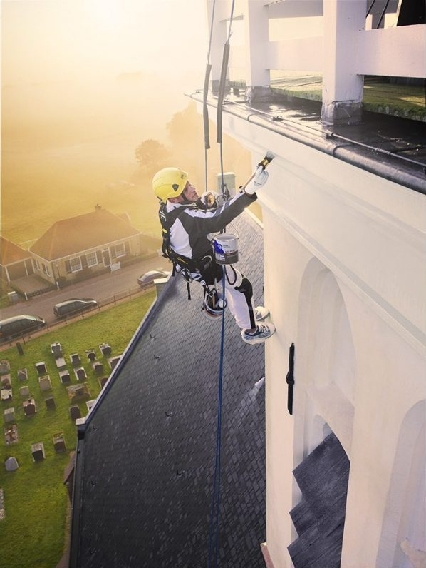 Pro gold painter church abseiling morning light sun painting