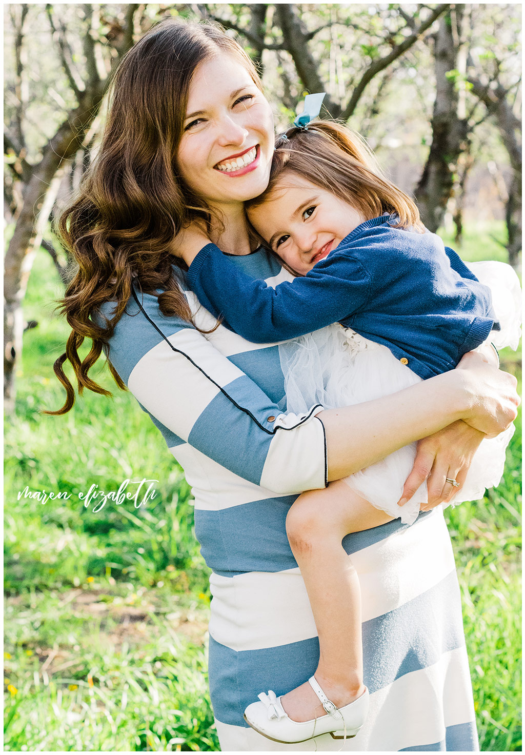 Provo Orchard Family Pictures in the spring. The family chose a neutral blue pallet for their outfits which was perfect for the season! | Gilbert Photographer | Mommy & Me