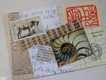 Many paper elements collaged on a postcard-sized substrate.