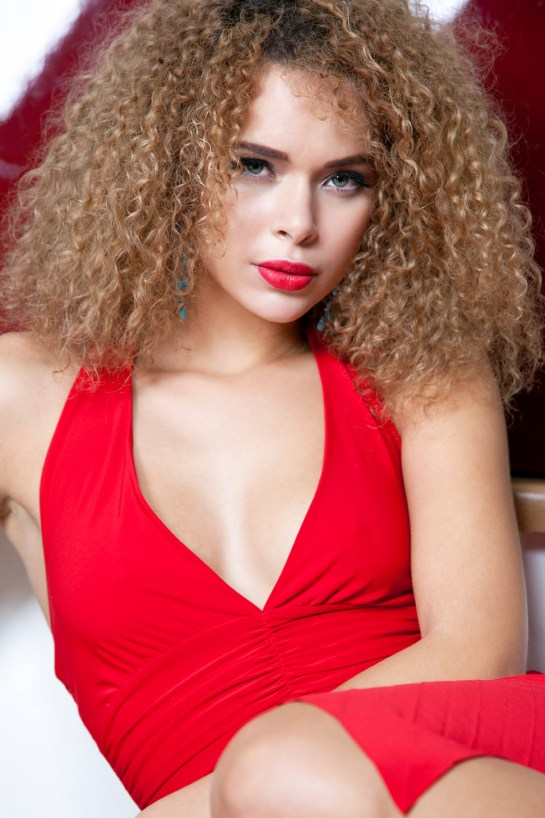 Photo: Fashion photographer London, Margaret Yescombe. Model in red dress with red lipstick. Photographed at Maggie's loft studio in Hackney, London