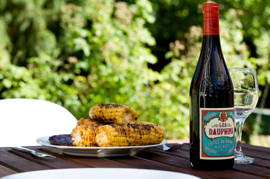 photo: BBQ sweetcorn french red wine bottle summer outdoor garden dining, image by British Photographer Margaret Yescombe