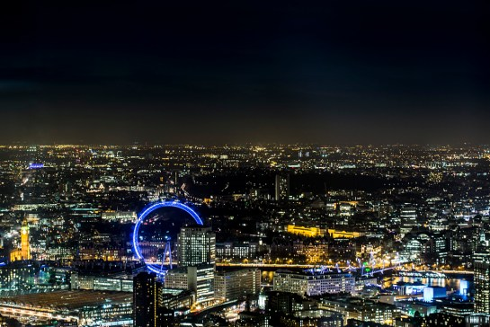 Photo: View of The London Eye, from the top of The Shard, London, at night. Photographer: Maggie Yescombe
