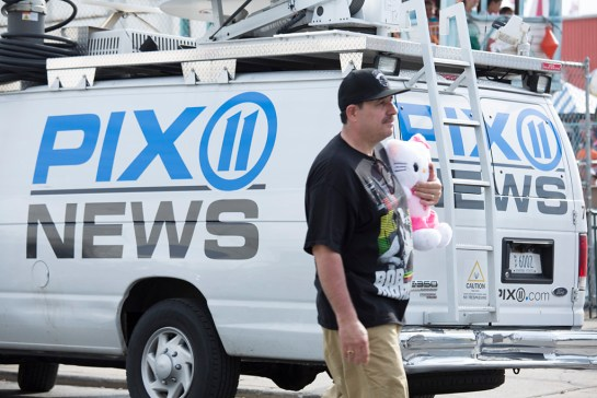 Photo: PIX 11 news reporter, at Coney Island Beach, Brooklyn, New York, beach re-opens, memorial day weekend, travel and documentary photography by fashion and pr photographer Margaret ( Maggie ) Yescombe, London UK