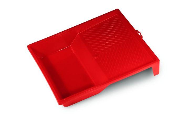 La vaschetta in plastica per raccogliere e scaricare il colore
