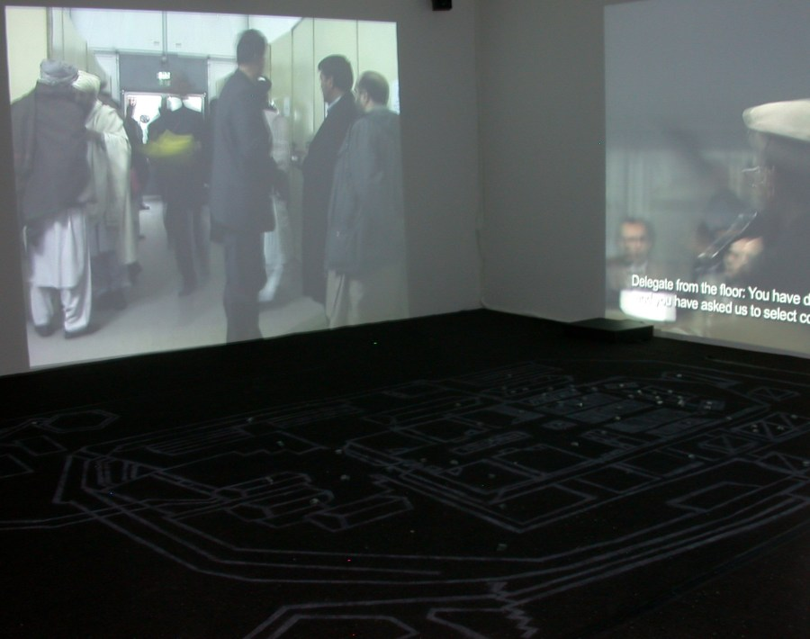Kabul: Constitutions at Eyebeam in 2005: an interactive 3-channel video installation (rt 1:30:00) with 12' x 17' carpet stenciled with map, 3 microcontrollers, 3 Pioneer DVD players, wire, and up to 62 infrared proximity or pressure sensors