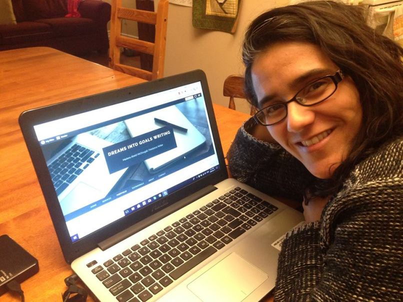 Dreams into Goals Writing Freelance Writing & Editing Services, Mariana Abeid-McDougall with her laptop