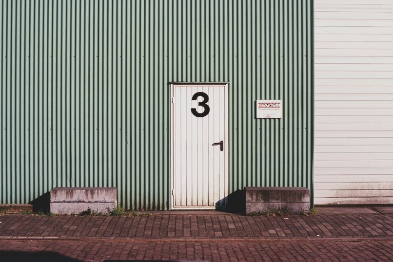 Storage facility door, photo by florencia vidana on unsplash. Long-term travel with kids