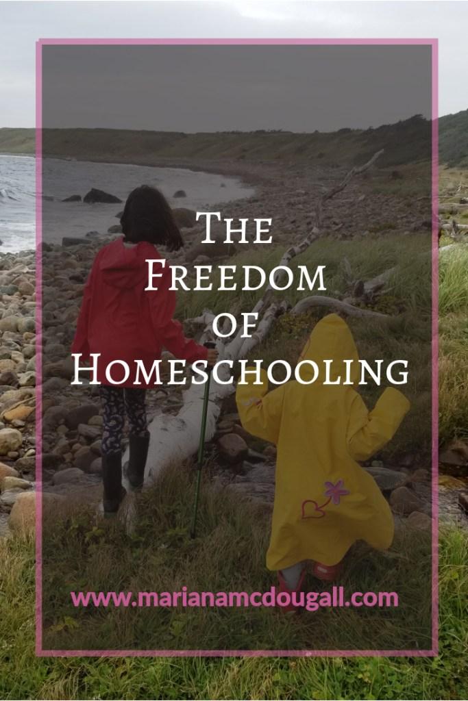 the freedom of homeschooling, www.marianamcdougall.com, 2 girls in raincoats walking along a rocky beach