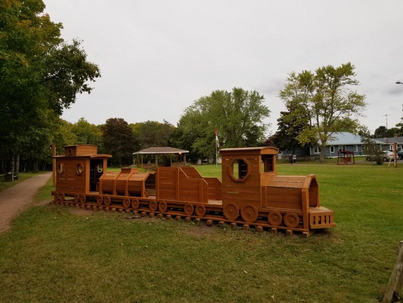 Wooden train at the playground next to the Canadian Potato Museum.